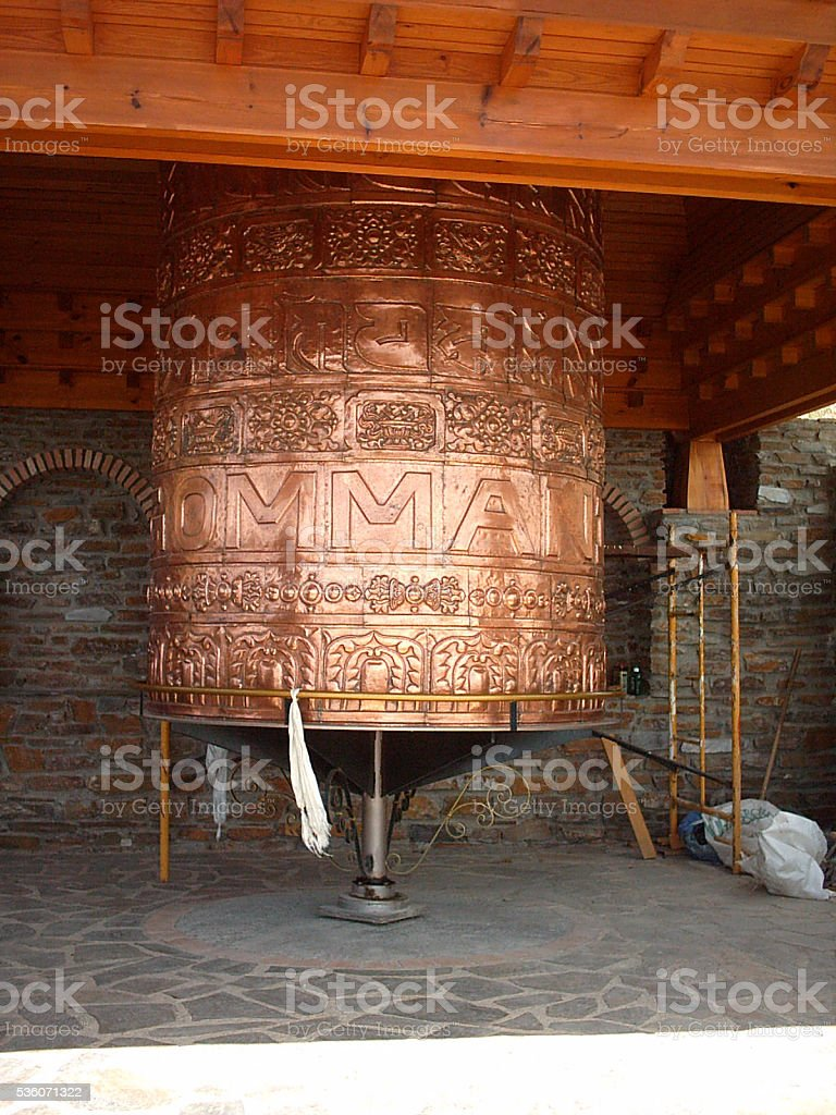 Prayer wheel in a buddhist temple stock photo