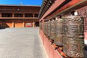Prayer wheels in a tibetan temple of ShuHe Old Town