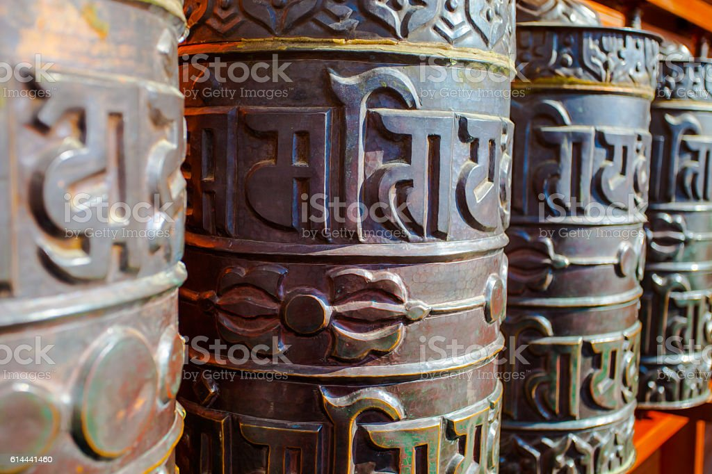 prayer wheels in Buddhist temple stock photo