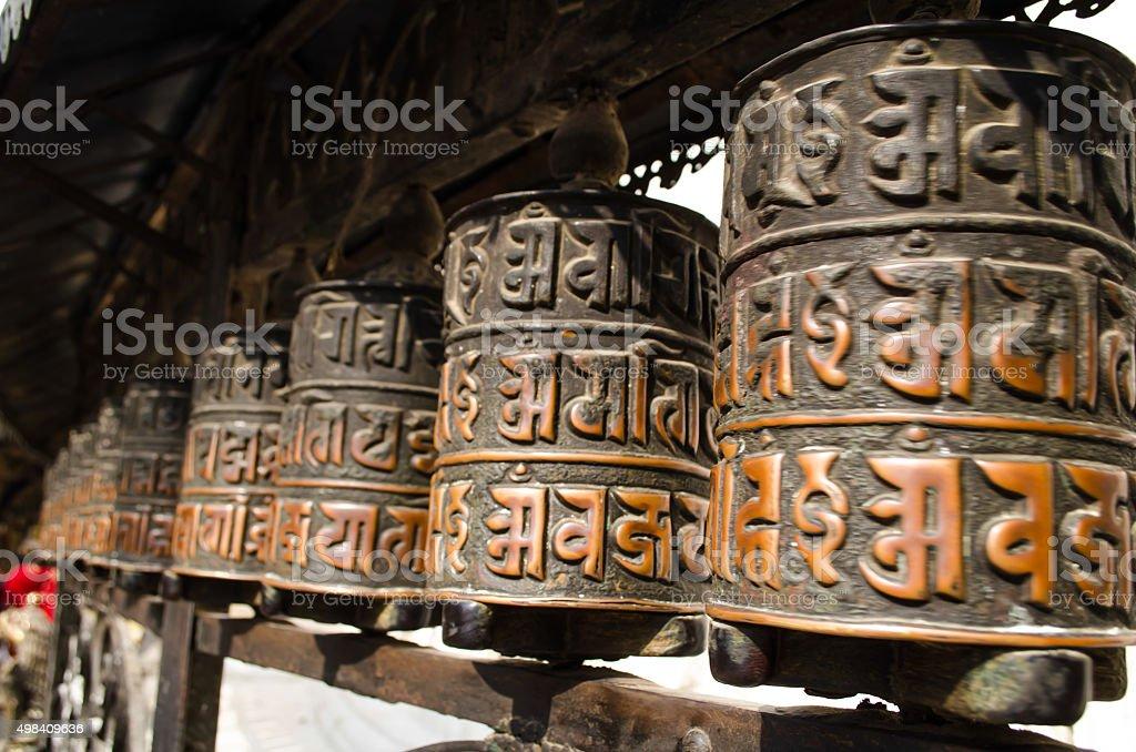 Prayer wheels in Swayambhunath, Nepal. stock photo