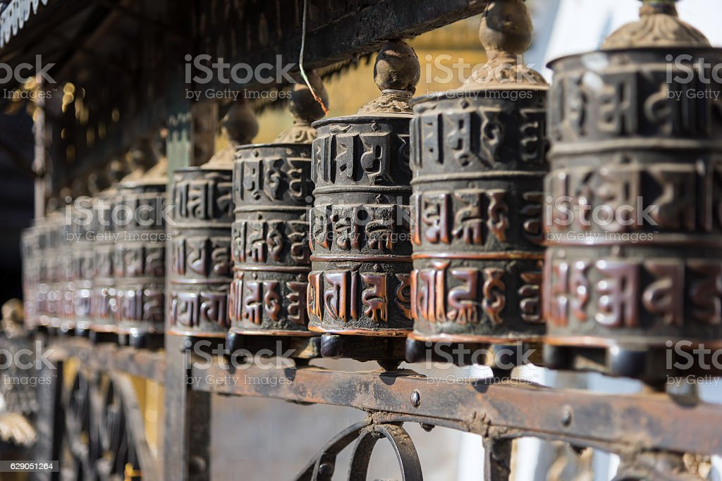 Prayer wheels  in Swayambhunath temple ,Kathmandu, Nepal. stock photo
