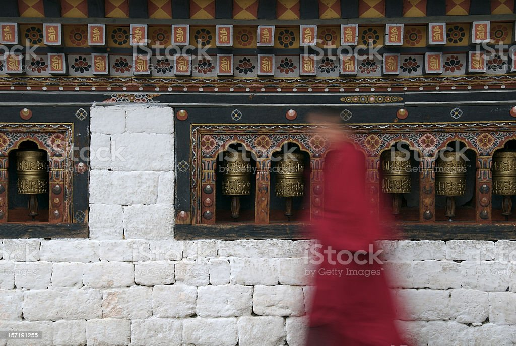 Prayer wheels with monk stock photo