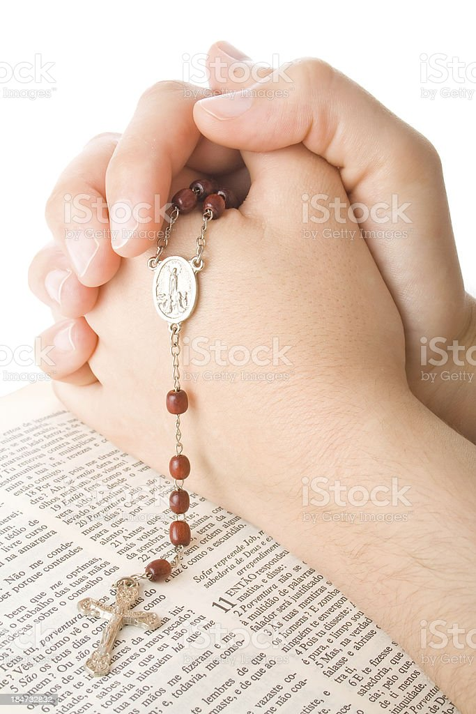 prayer with a rosary and bible royalty-free stock photo