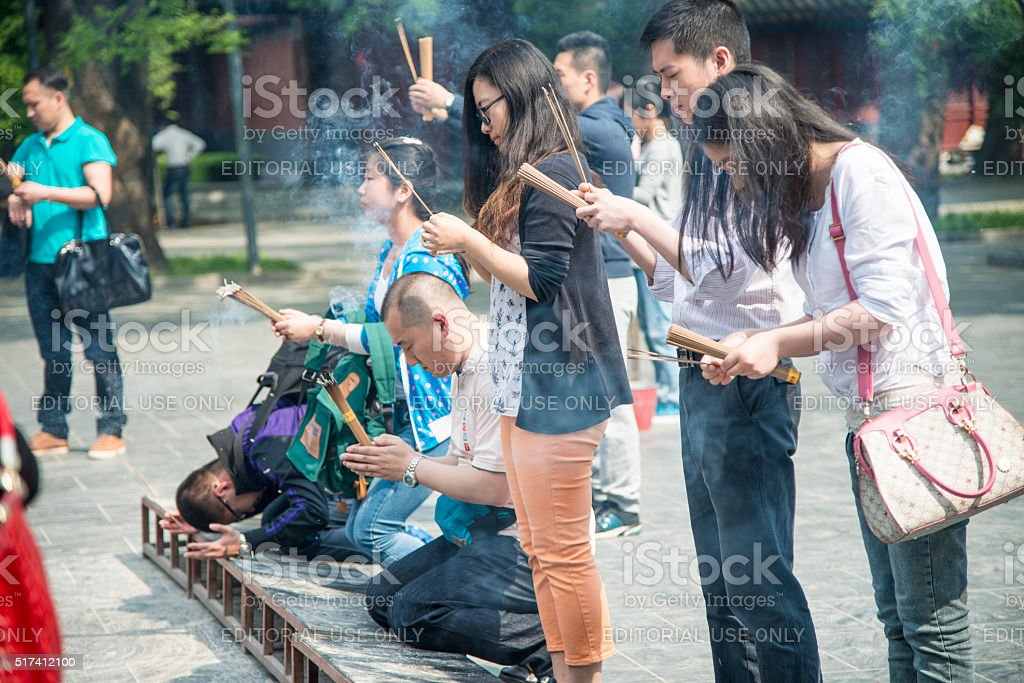 Prayers in front of YongHeGong temple in Beijing stock photo