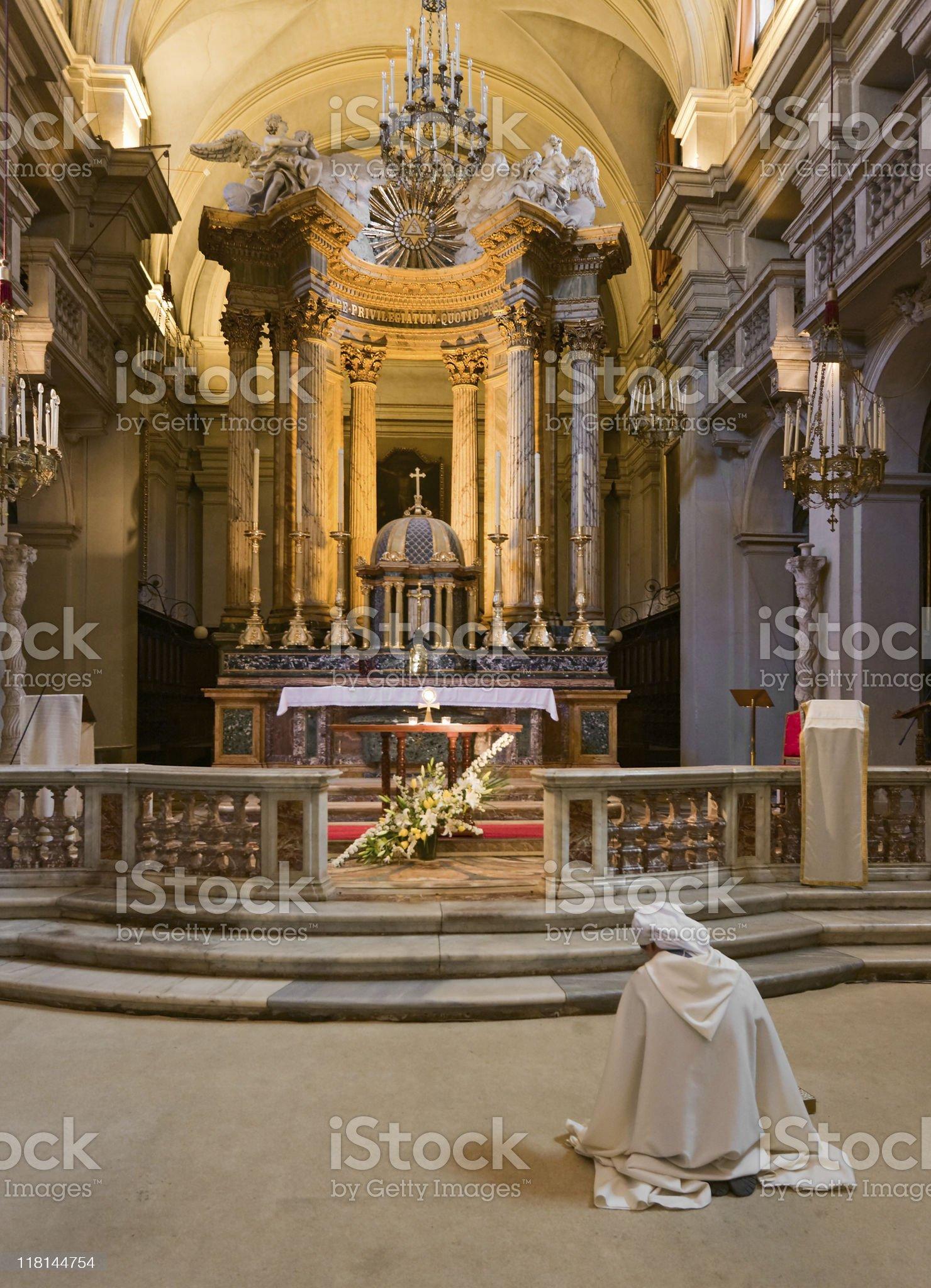 Praying alone royalty-free stock photo
