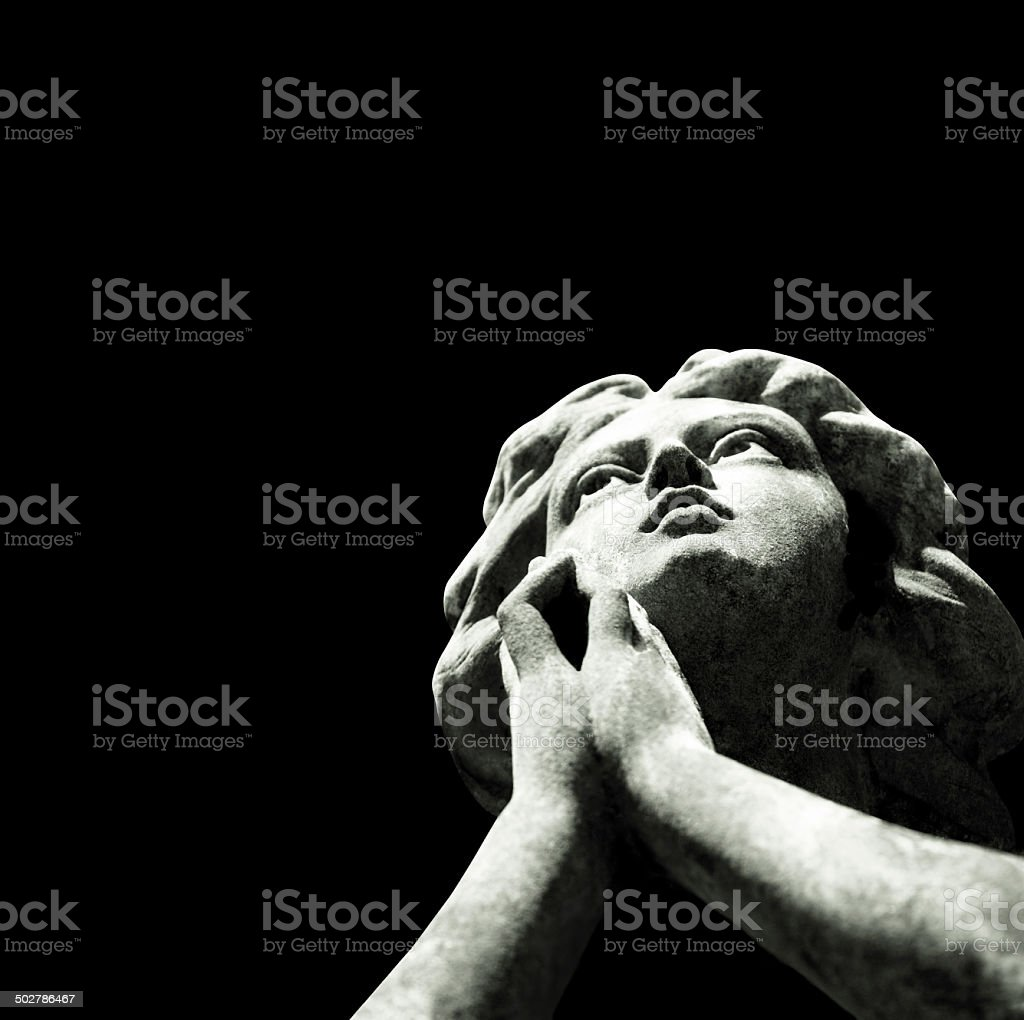 Praying angel isolated on square black background, copy space stock photo