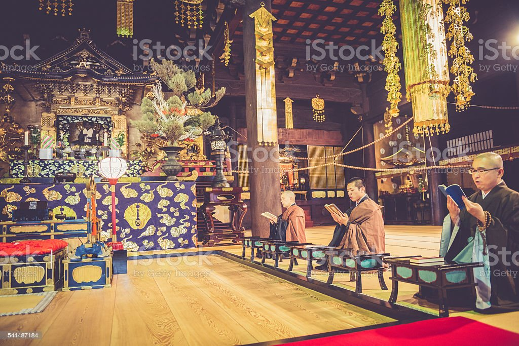 Praying at Buddhist Chion-ji Temple in Kyoto, Japan stock photo
