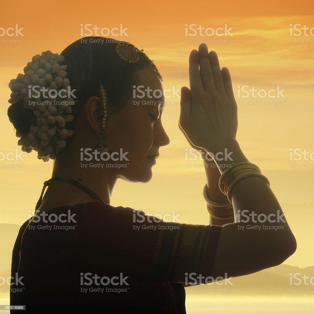 praying at dawn royalty-free stock photo