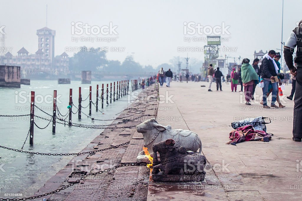 Praying at the ganges river stock photo