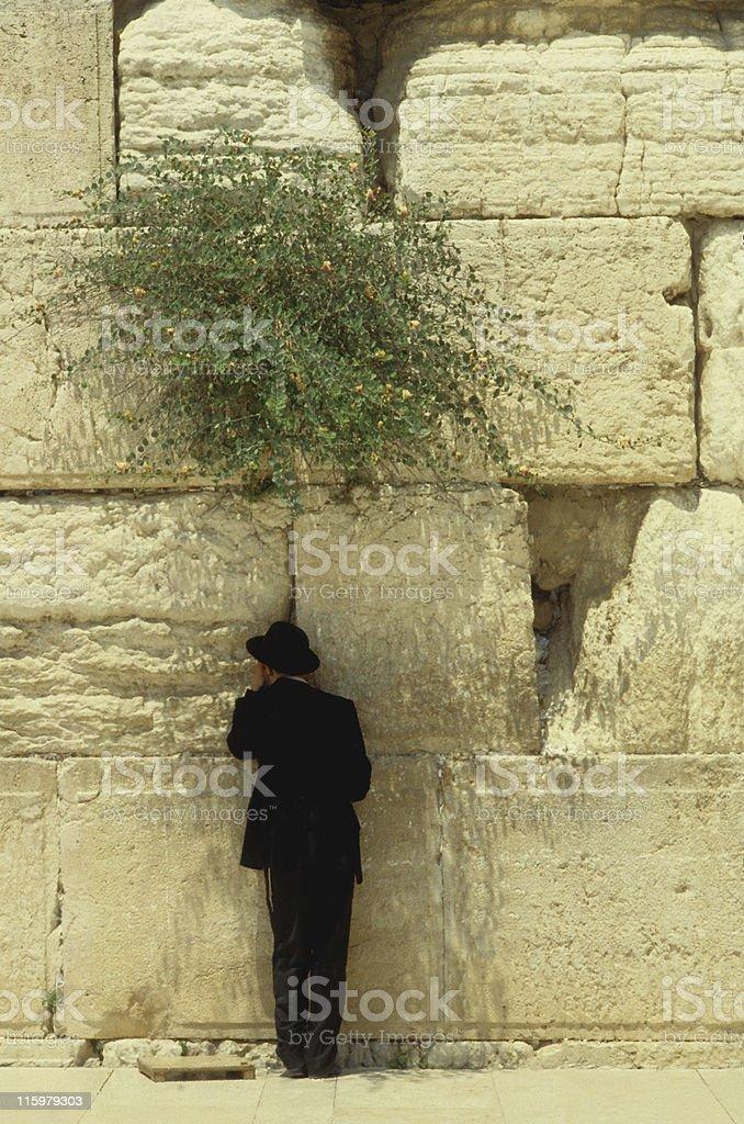 Praying at the Wailing Wall in Jerusalem royalty-free stock photo