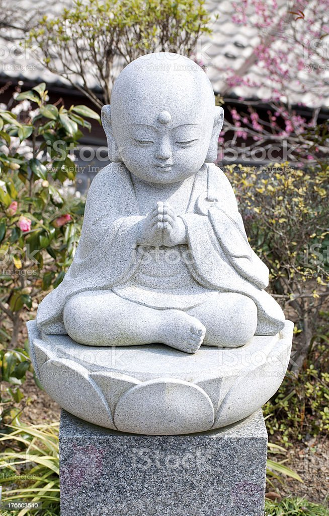 Praying Baby Budda Statue royalty-free stock photo