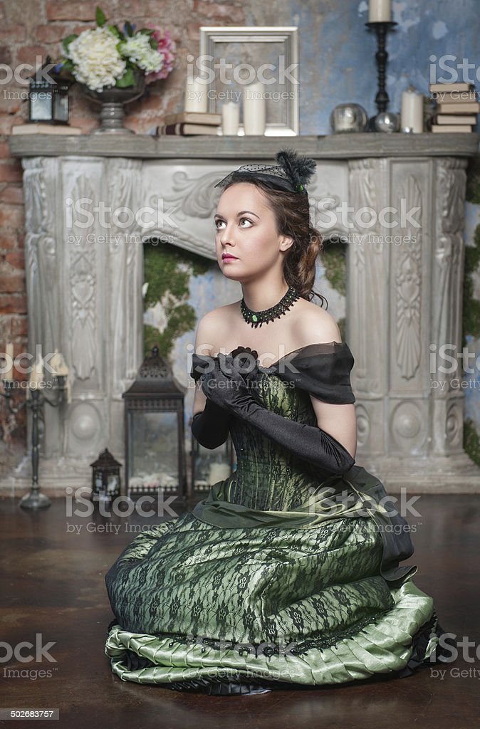 Praying beautiful woman in medieval dress stock photo
