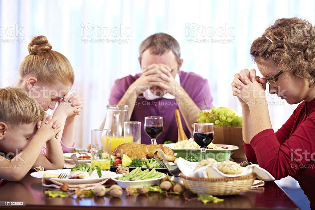 Praying before dinner royalty-free stock photo