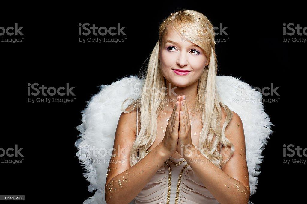 Praying blond angel royalty-free stock photo