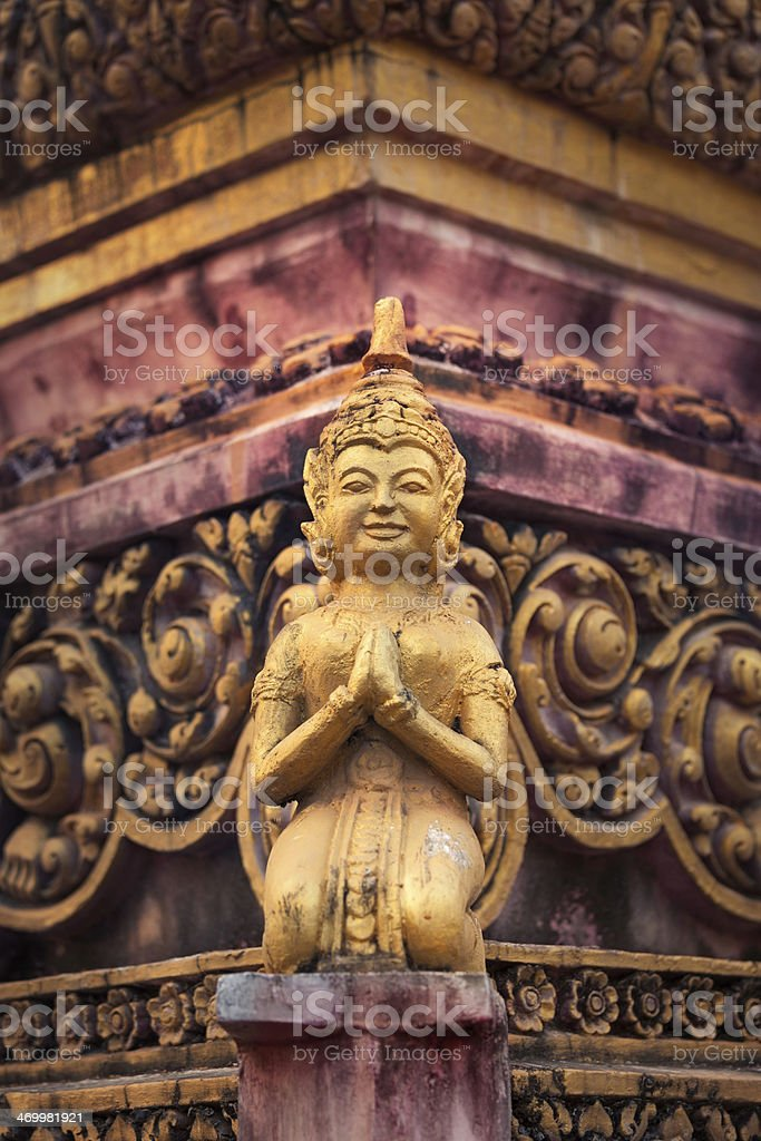 Praying buddhist sculpture royalty-free stock photo