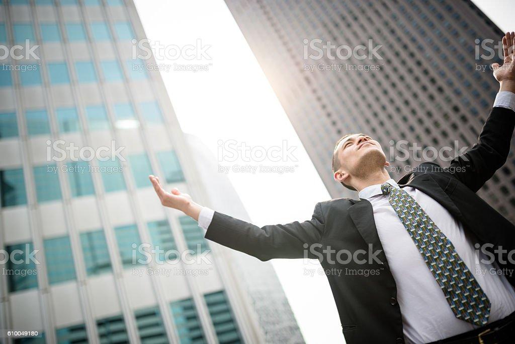 praying business man in tokyo stock photo