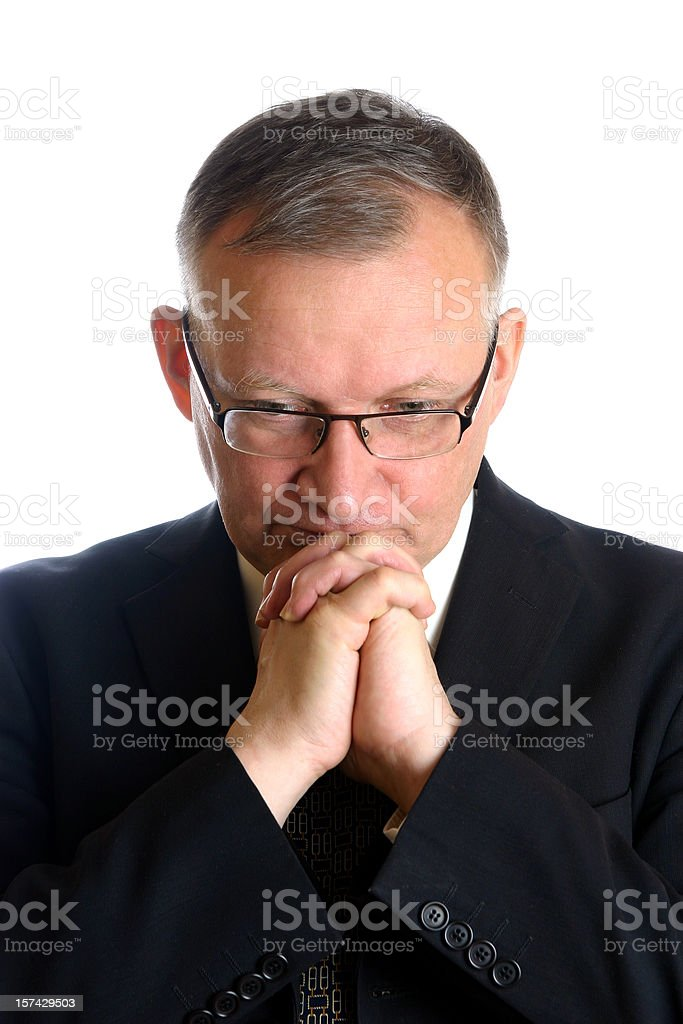 Praying businessman royalty-free stock photo