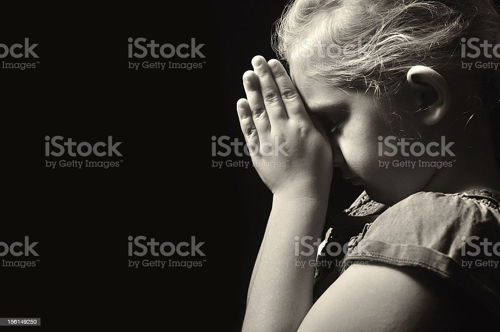 Praying child. royalty-free stock photo