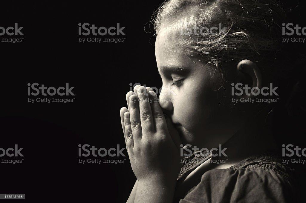 Praying child. stock photo
