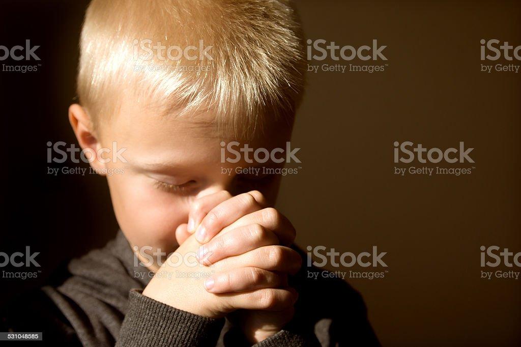 Praying child stock photo