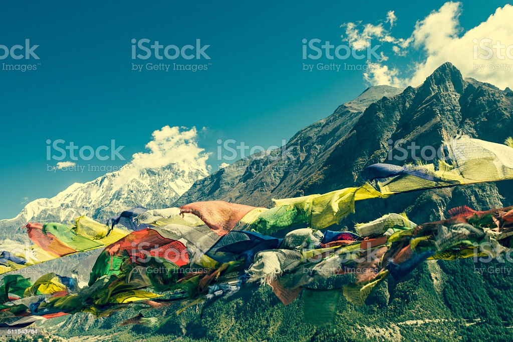 Praying flags on mountain background. stock photo