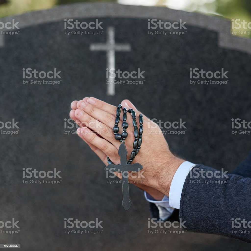 Praying for eternal peace stock photo