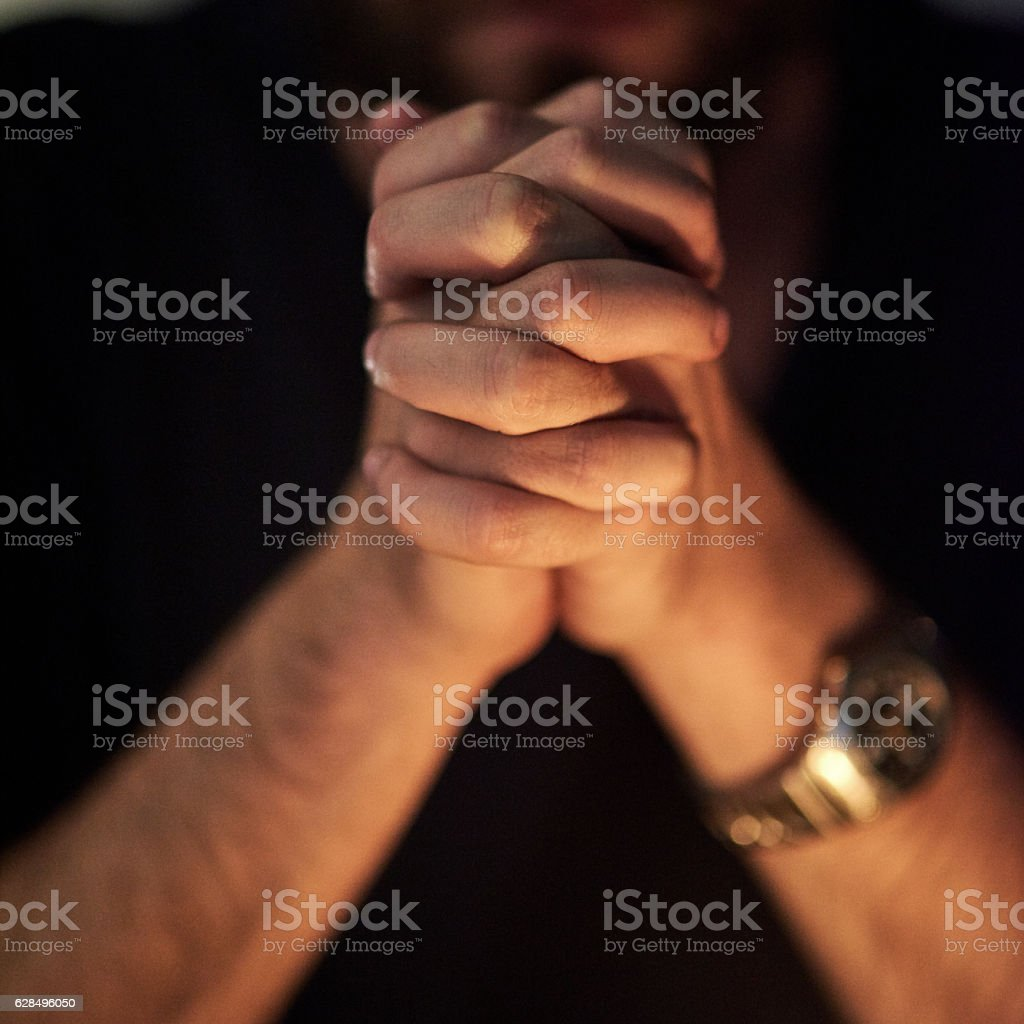 Praying for forgiveness stock photo
