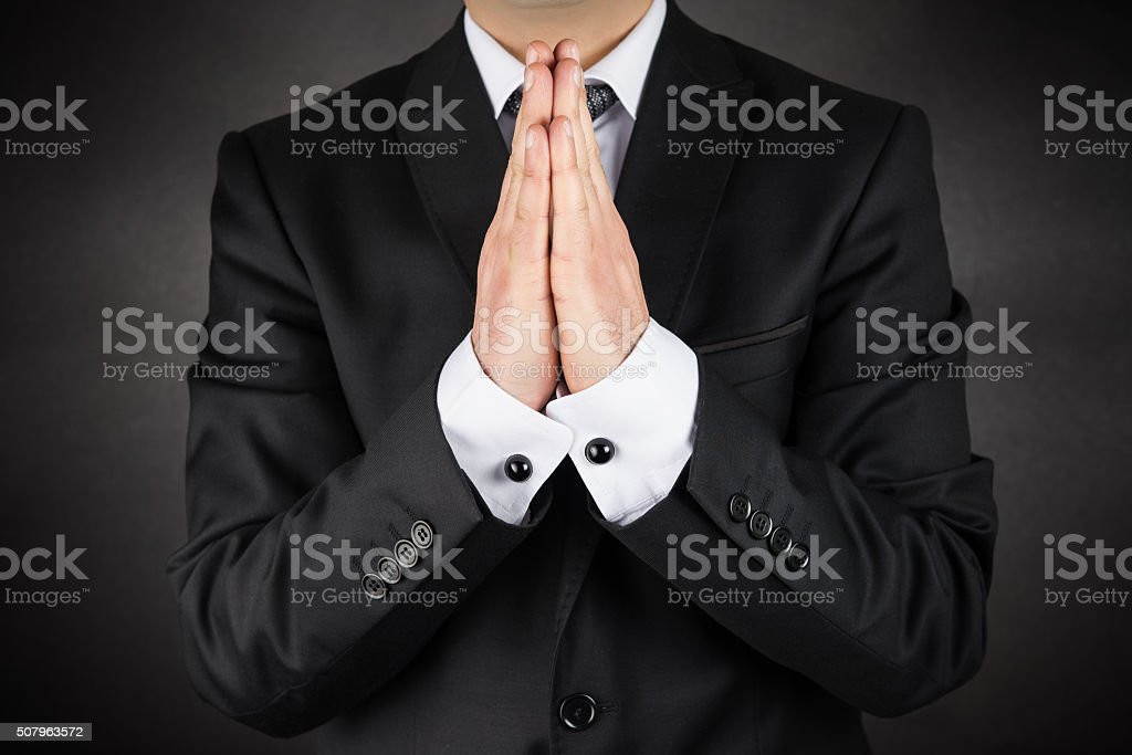 Praying for success stock photo