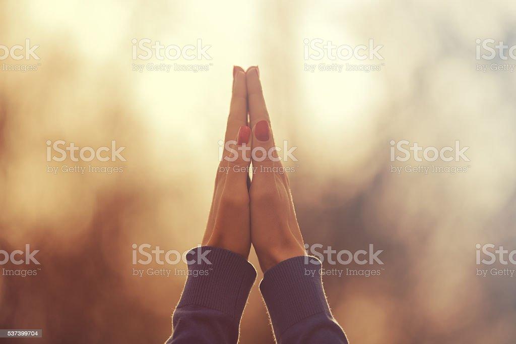 Praying for the sun. stock photo
