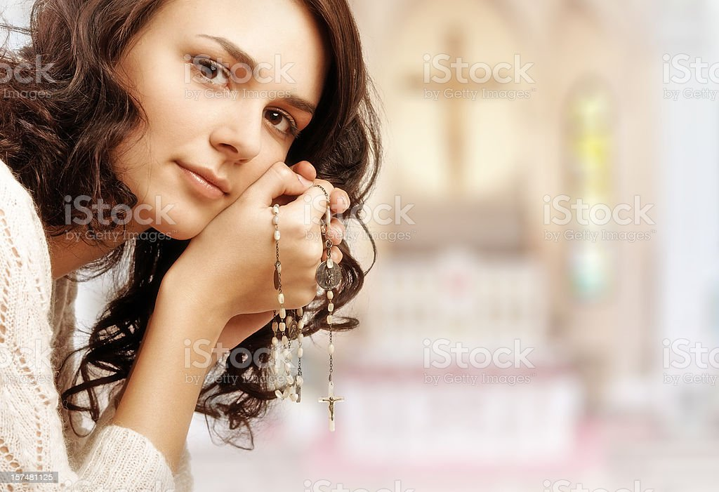 praying girl in the temple stock photo