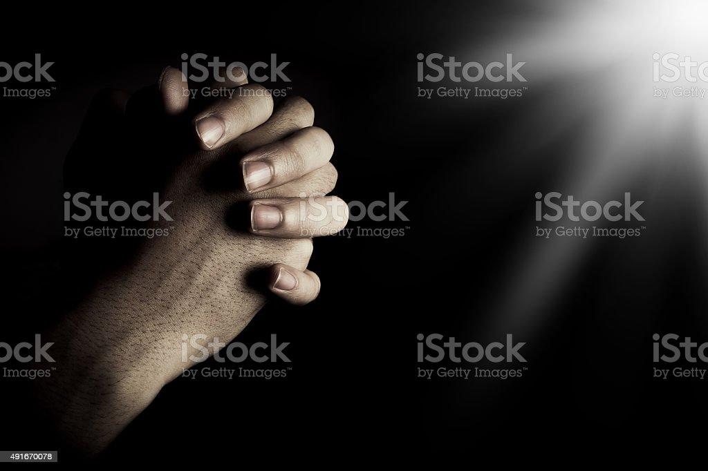 Praying hand stock photo