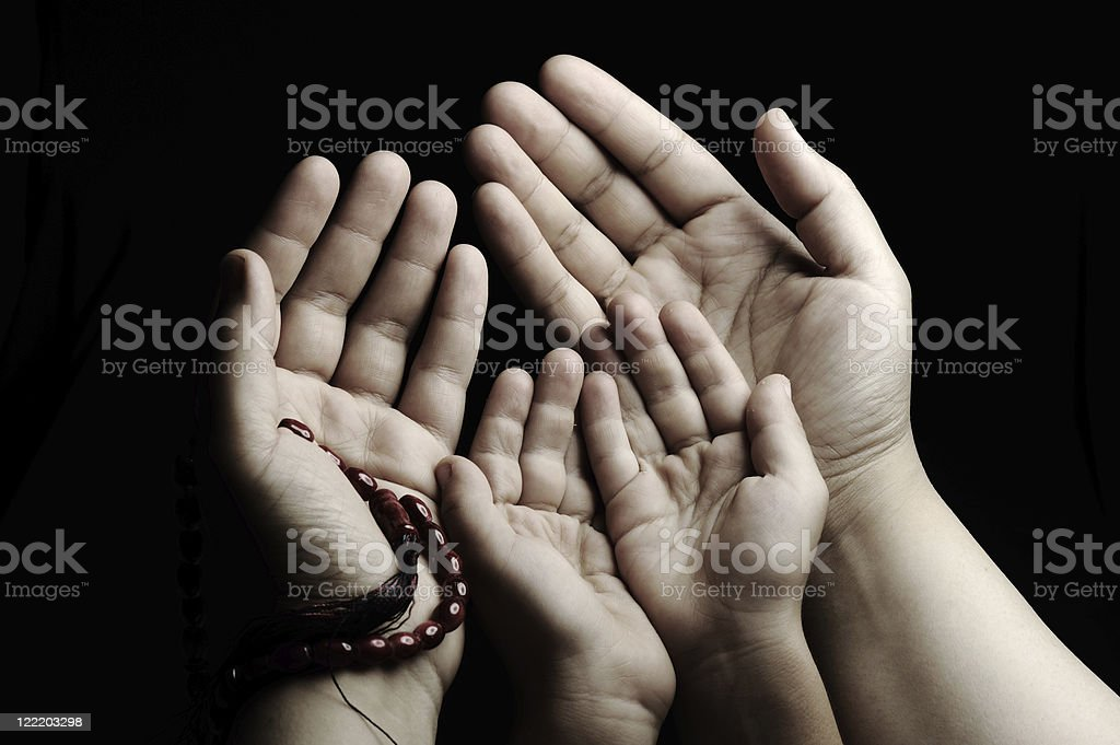 Praying hands, parent and child stock photo