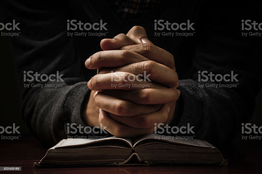 Praying Hands With Bible stock photo