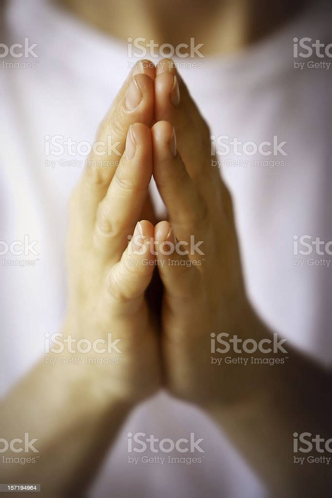 Praying hands with white background royalty-free stock photo