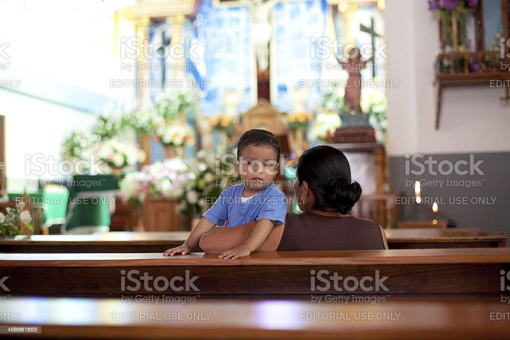 Praying in a church stock photo
