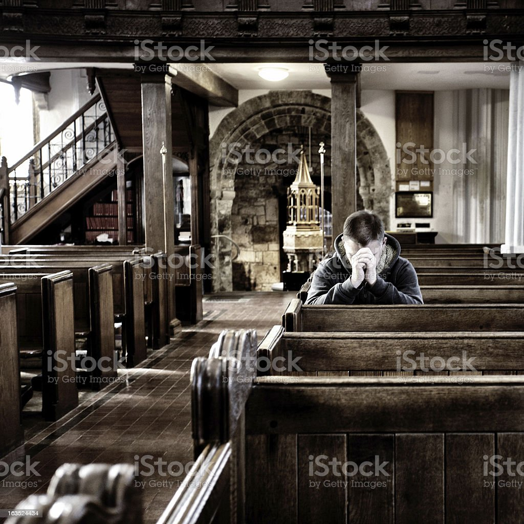 Praying in a church, UK stock photo