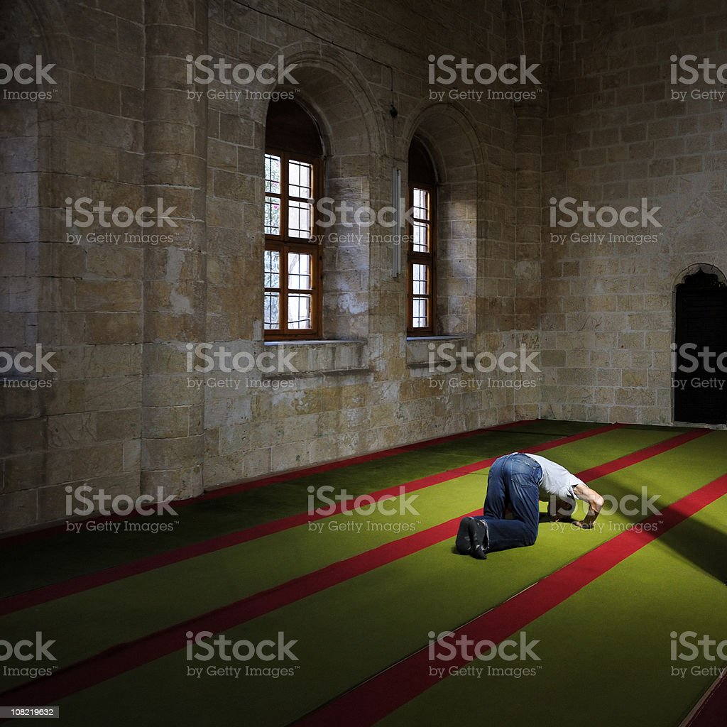 Praying In a Mosque royalty-free stock photo