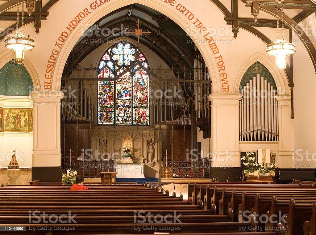 Praying in an Older Church Pews royalty-free stock photo