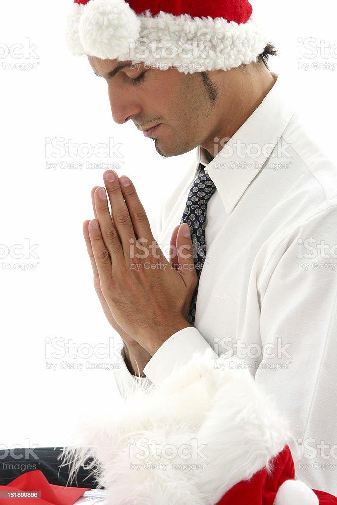 Praying in Christmas royalty-free stock photo