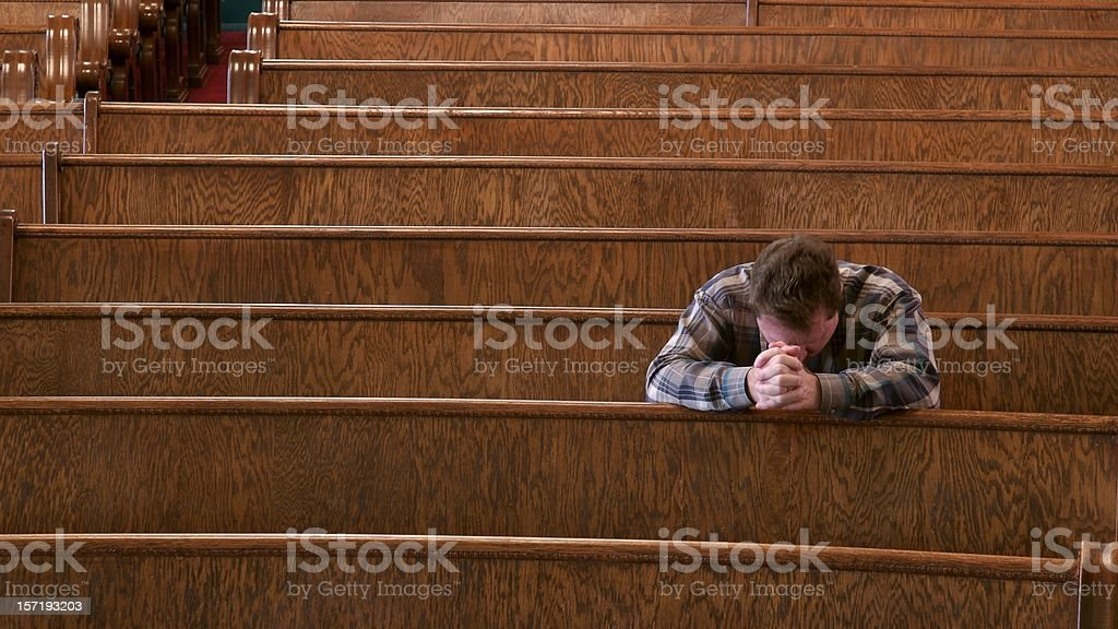 Praying in Church royalty-free stock photo