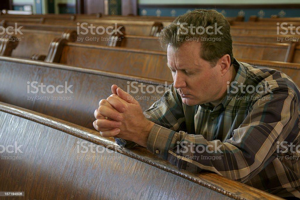 Praying in Church royalty-free stock photo