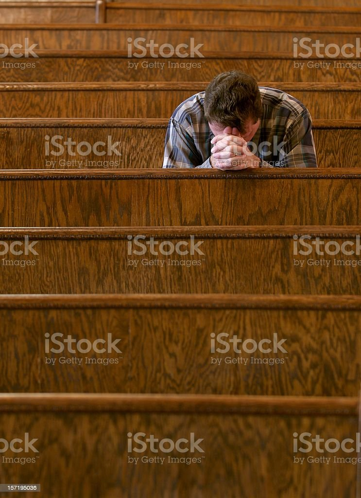 Praying in Church stock photo