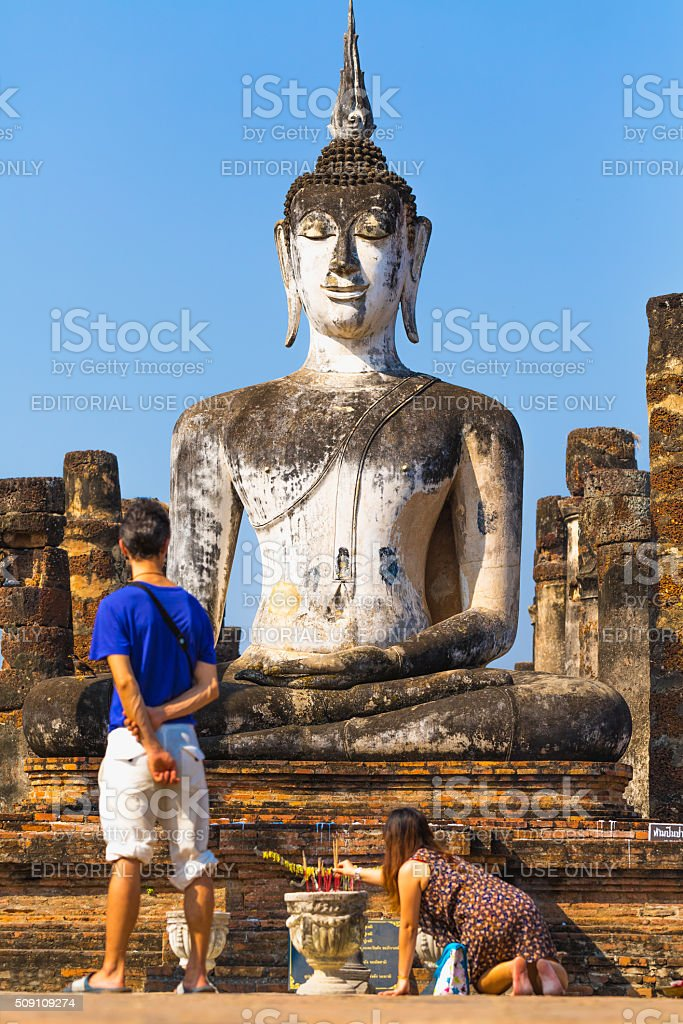 Praying in front of the buddha in Sukhothai stock photo