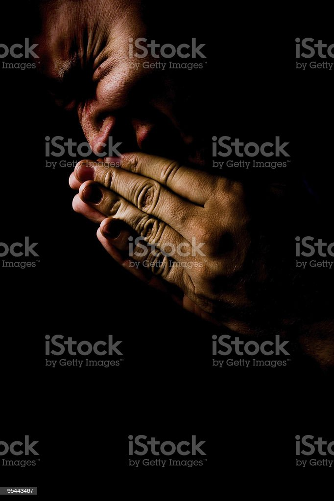 Praying in pain and darkness royalty-free stock photo