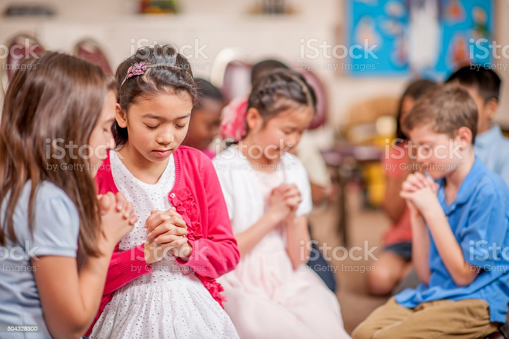 Praying in Small Groups stock photo