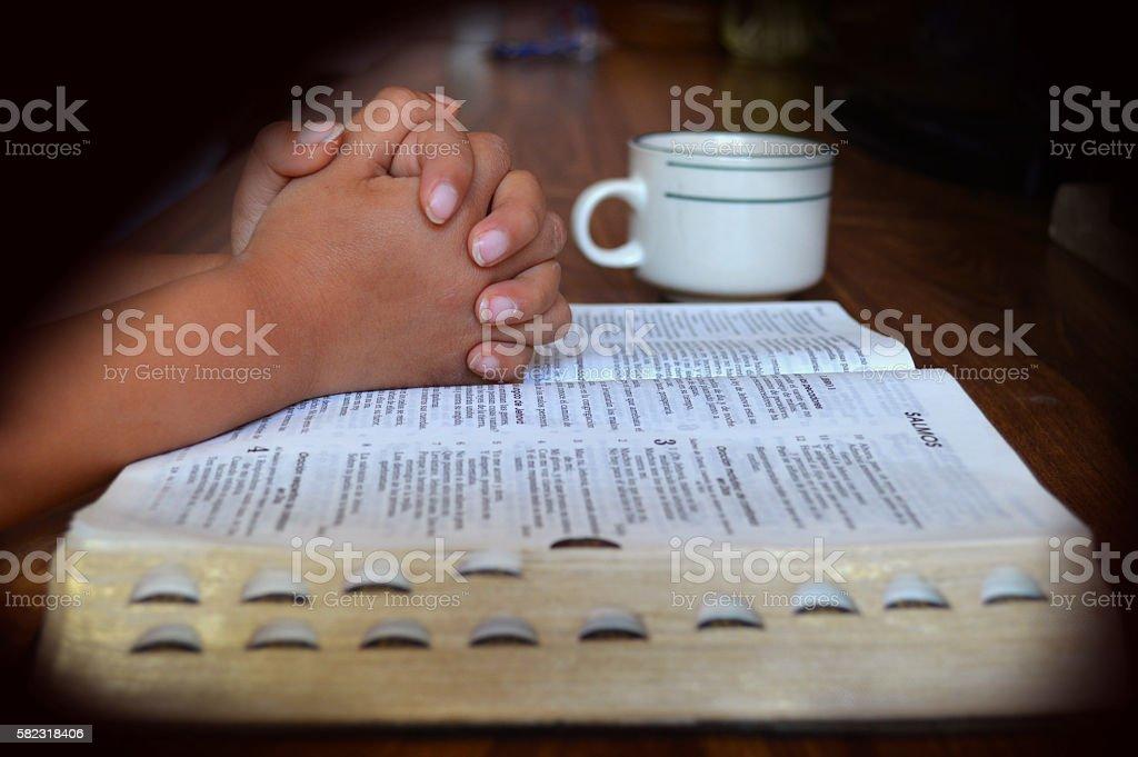 praying in the morning stock photo