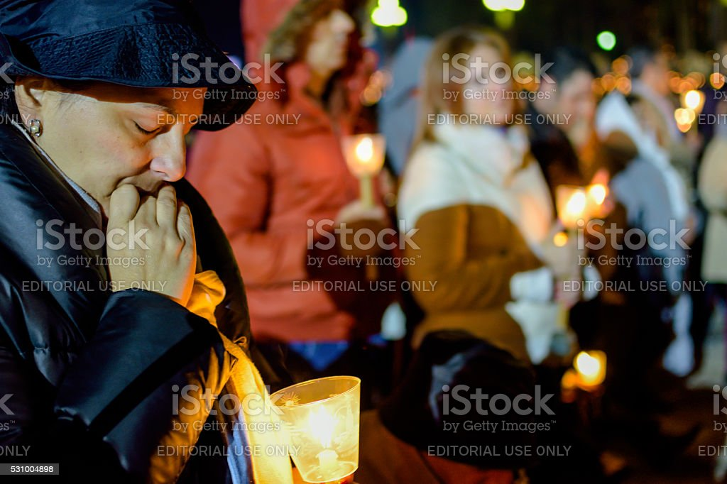 praying in the shrine of fatima stock photo