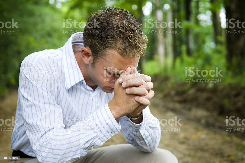 Praying in the woods royalty-free stock photo