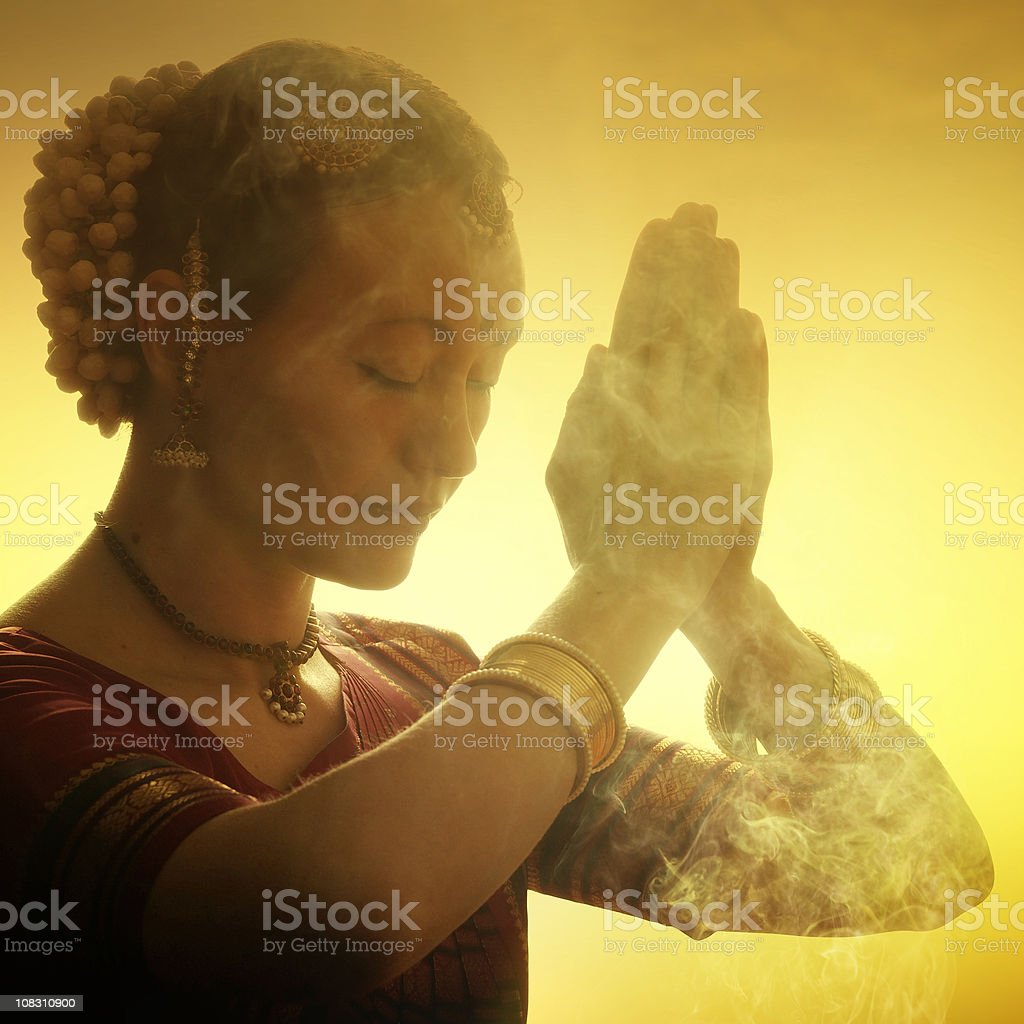 praying indian woman stock photo