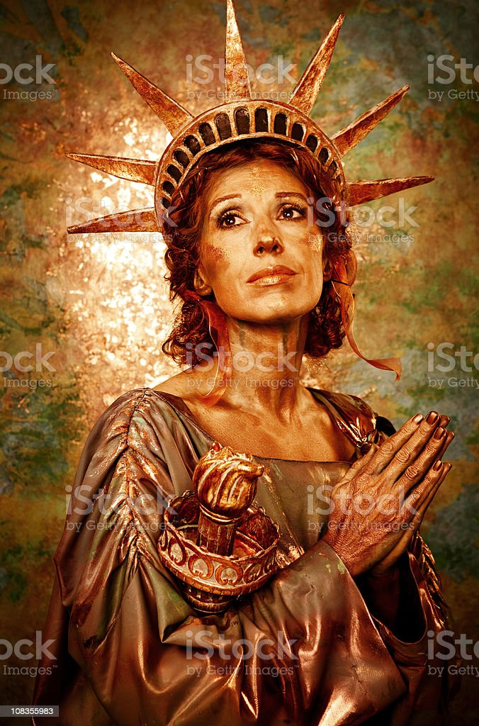 Praying Lady Liberty royalty-free stock photo